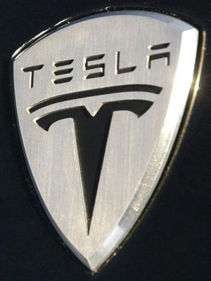 Эмблема марки автомобилей Tesla